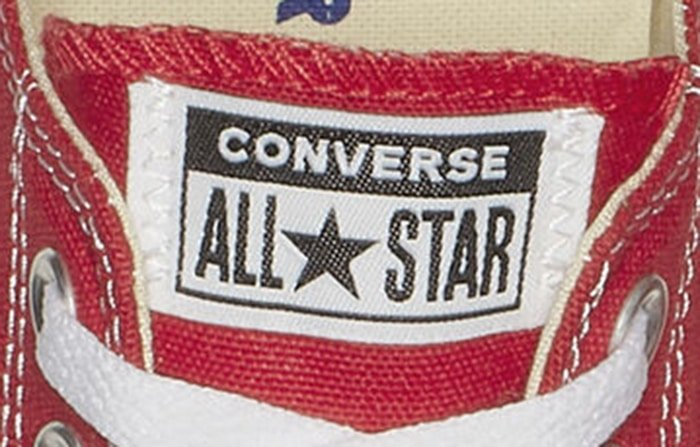 Red Low top Converse shoes with All Star logo patch
