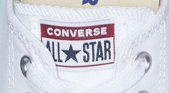 Low top Converse All Star logo patch