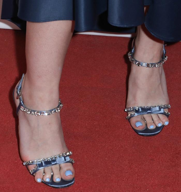 Dakota Fanning shows off her sky blue pedicure in Prada crystal-embellished sandals
