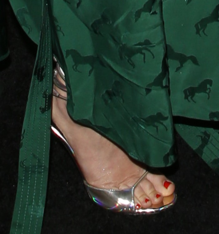 Drew Barrymore shows off her red pedicure in Stella McCartney sandals