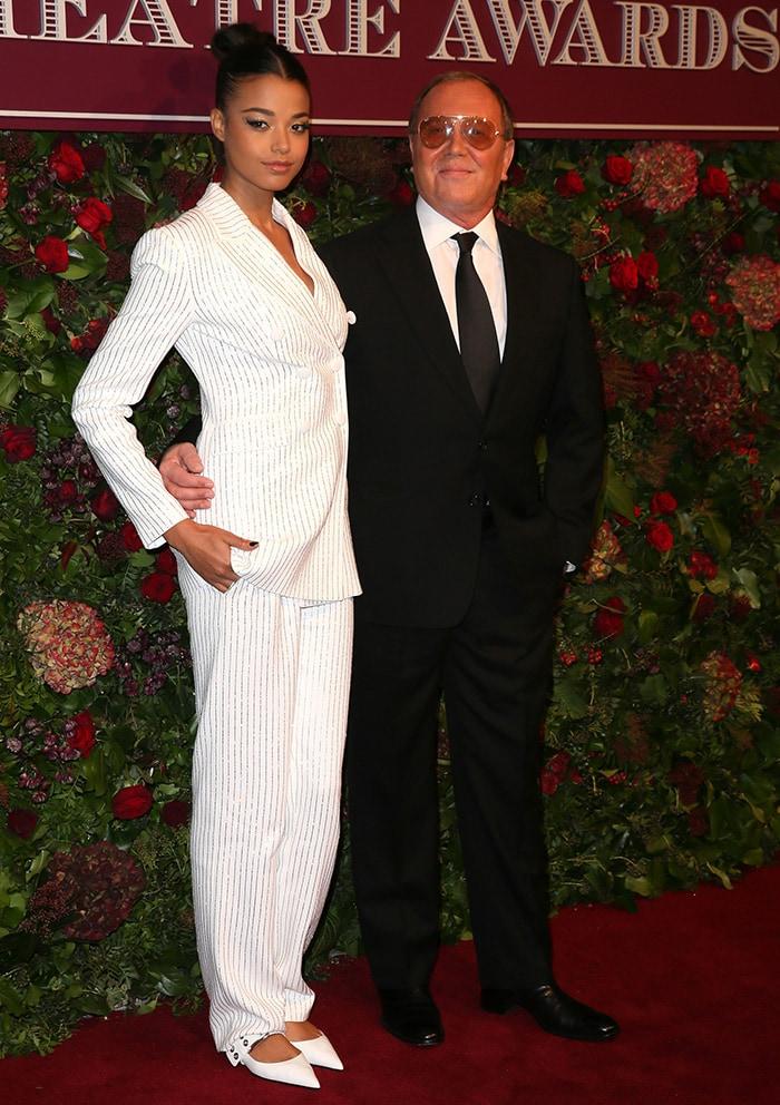 Ella Balinska poses with Michael Kors at the 2019 Evening Standard Theatre Awards held at the London Coliseum on November 24, 2019