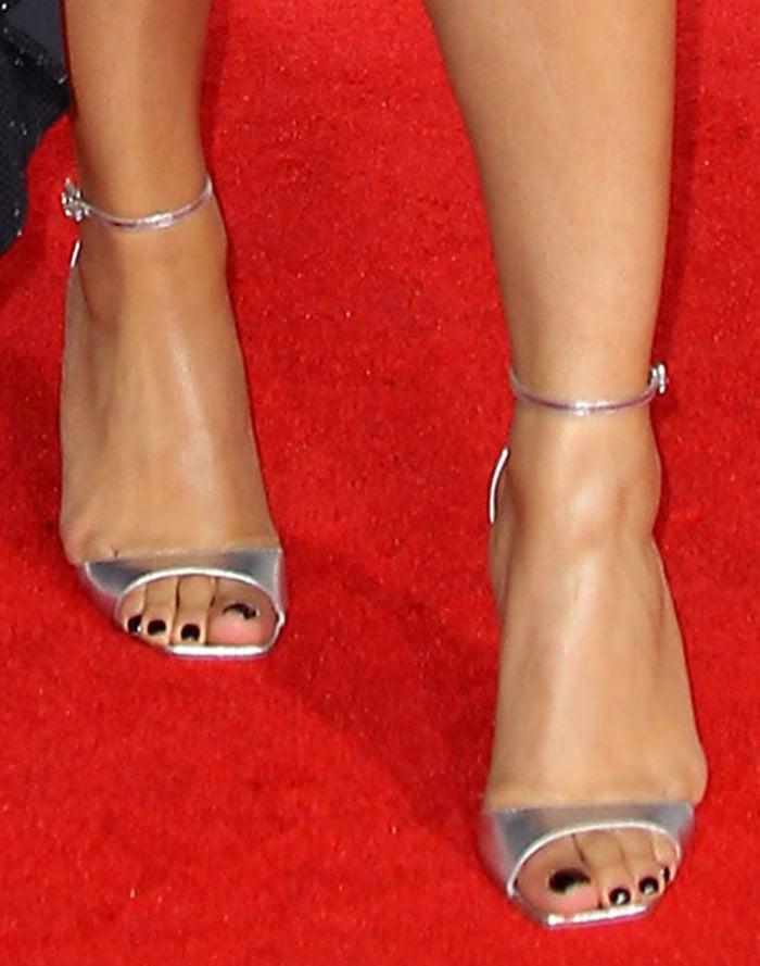 Ella Mai's sexy feet in metallic silver heels by Roger Vivier