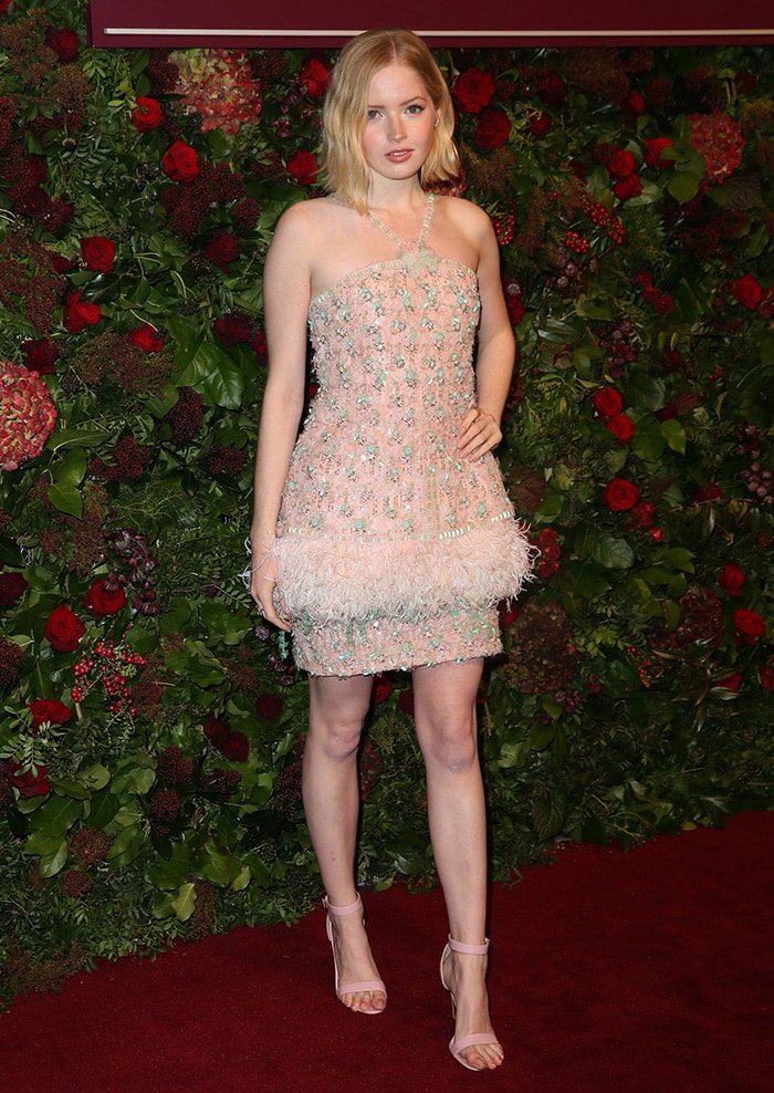 Ellie Bamber flaunted her sexy legs in a gem and feather-embellished Chanel dress