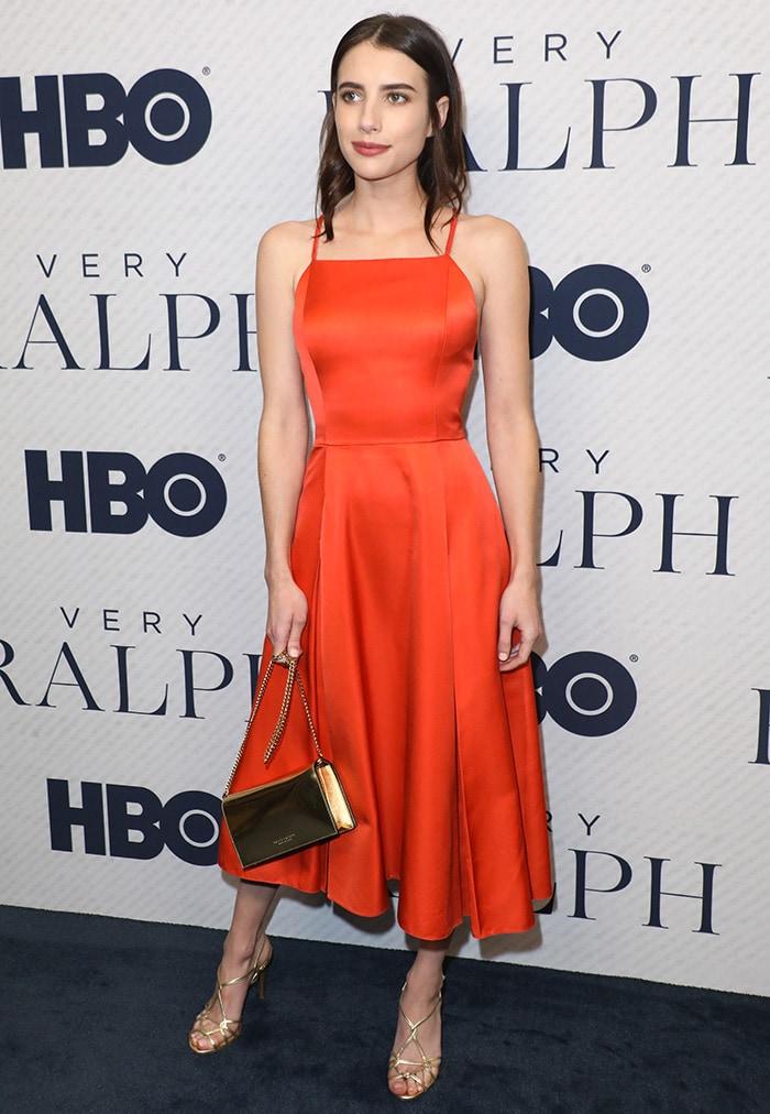 Emma Roberts fittingly dressed in an orange Ralph Lauren creation