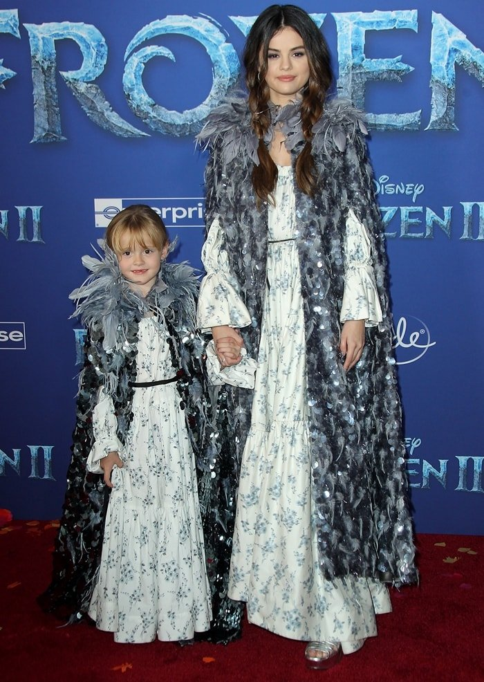 Gracie Elliot Teefey and Selena Gomez wearing matching, Frozen-inspired outfits