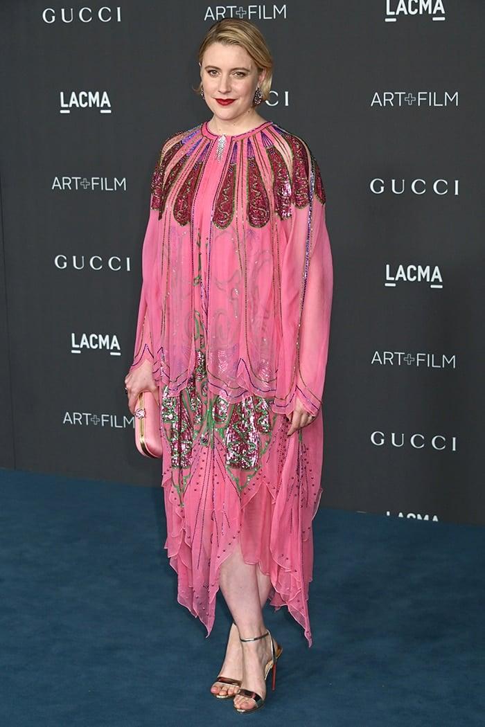 Greta Gerwig wears a Gucci pink silk layered dress