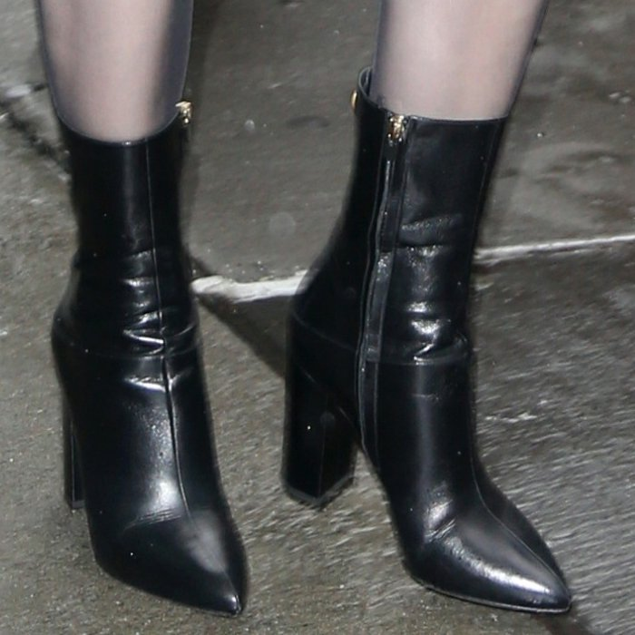 Hailee Steinfeld's Valentino Garavani Ringstud ankle boots with gold-tone Ringstud detail at the heel
