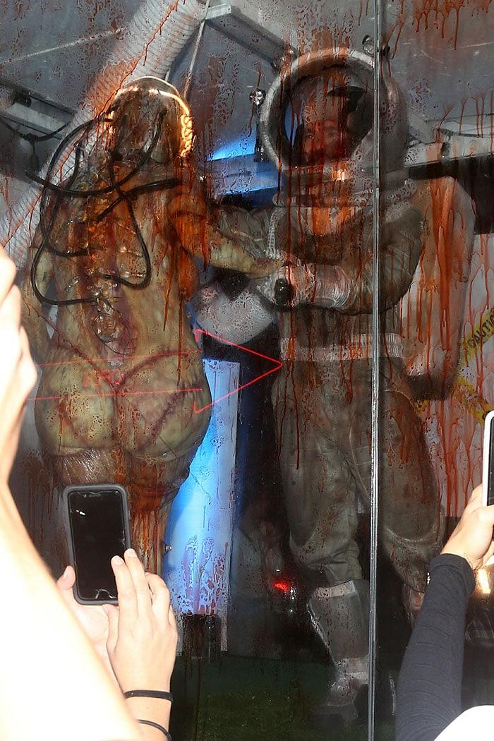 Heidi Klum and Tom Kaulitz in a bloody glass truck