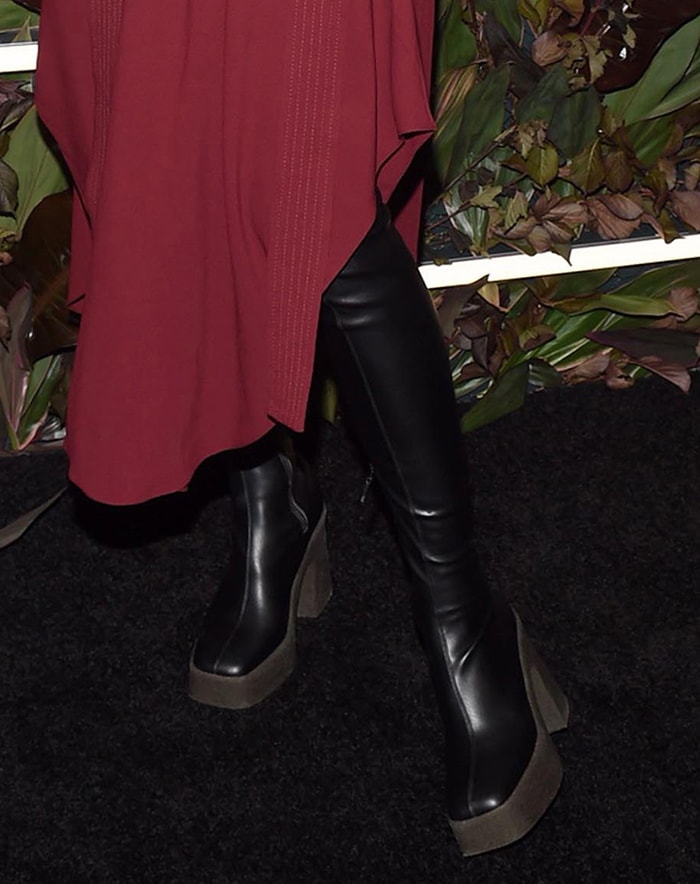 Hilary Rhoda teams her dress with Stella McCartney over-the-knee boots