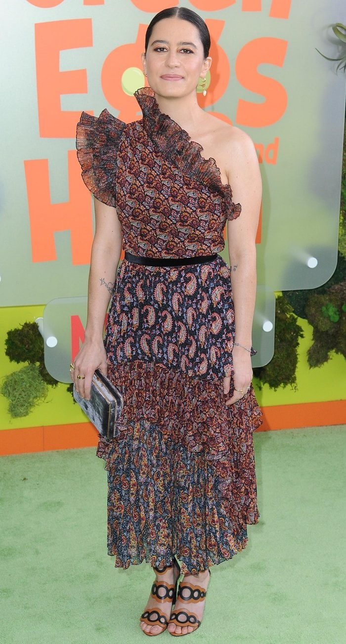 Ilana Glazer donned a rich brown, red and mustard-yellow paisley print Kamala dress