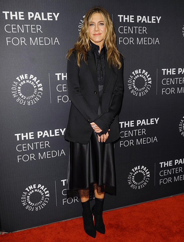 Jennifer Aniston in a bizarre black dress and long black tuxedo