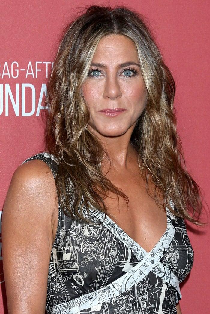 Jennifer Aniston wears her signature beach waves hairstyle