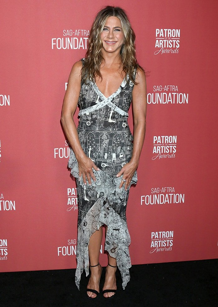 Jennifer Aniston tries something new in a vintage John Galliano printed dress