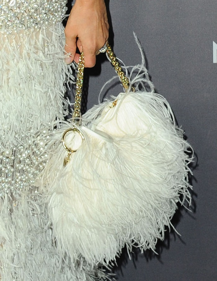 Jessica Alba carries a Jimmy Choo feather bag