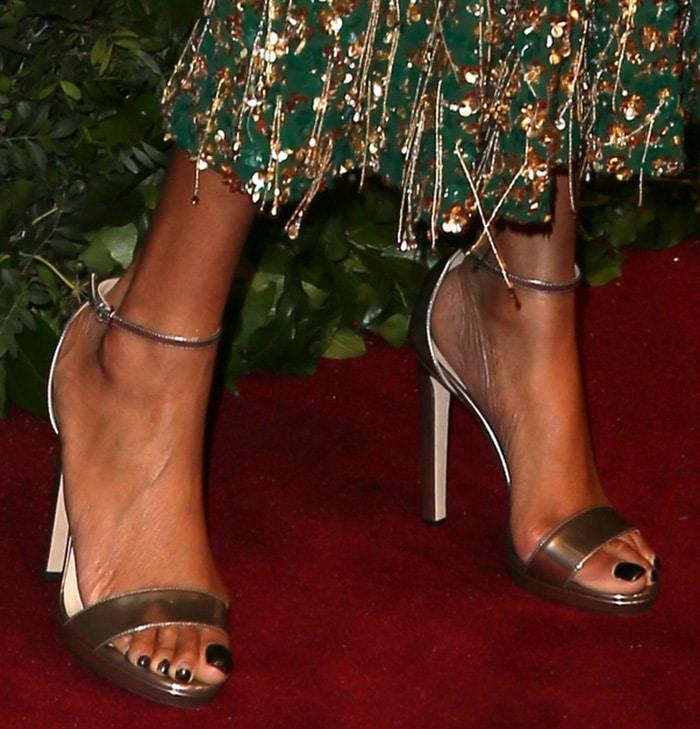 Jourdan Dunn shows off her sexy feet in metallic Jimmy Choo sandals