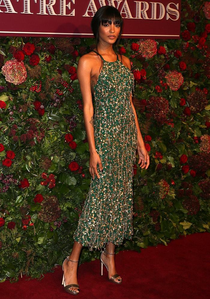 Jourdan Dunn is a Chrismassy in green embellished Michael Kors dress
