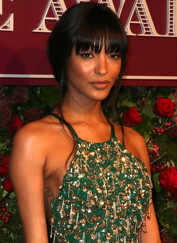 Jourdan Dunn wears an updo with face-framing wisps and fringe