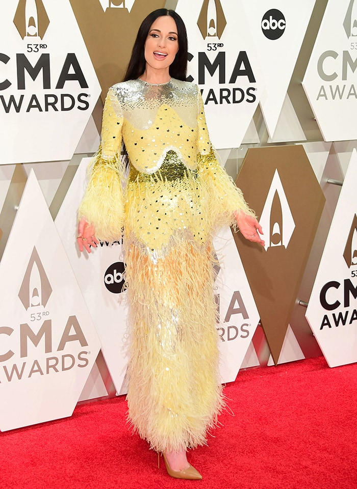 Kacey Musgraves dons a striking yellow sequined dress by Valentino