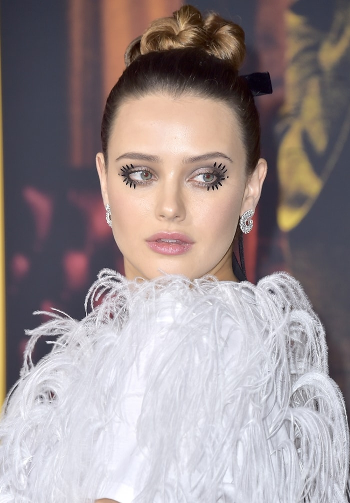 Katherine Langford's dramatic eyelashes by makeup artist Fiona Stiles and earrings from Chopard's Precious Lace Collection