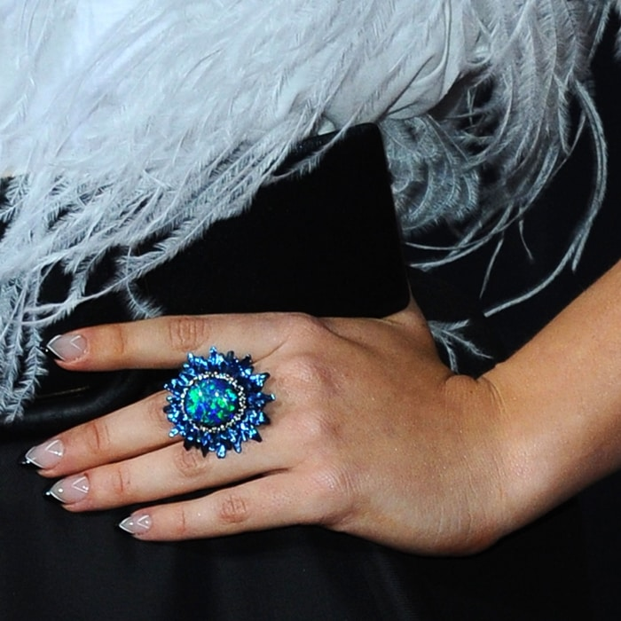 Katherine Langford's Chopard ring featuring a 19.93-carats oval-shaped opal, .74-carats of tsavorites, .42-carats of sapphires, .39-carats of colored diamonds, .19-carats of diamonds, and .09-carats of lazulites in 18k white gold and titanium from the Fleur d'Opales Collection