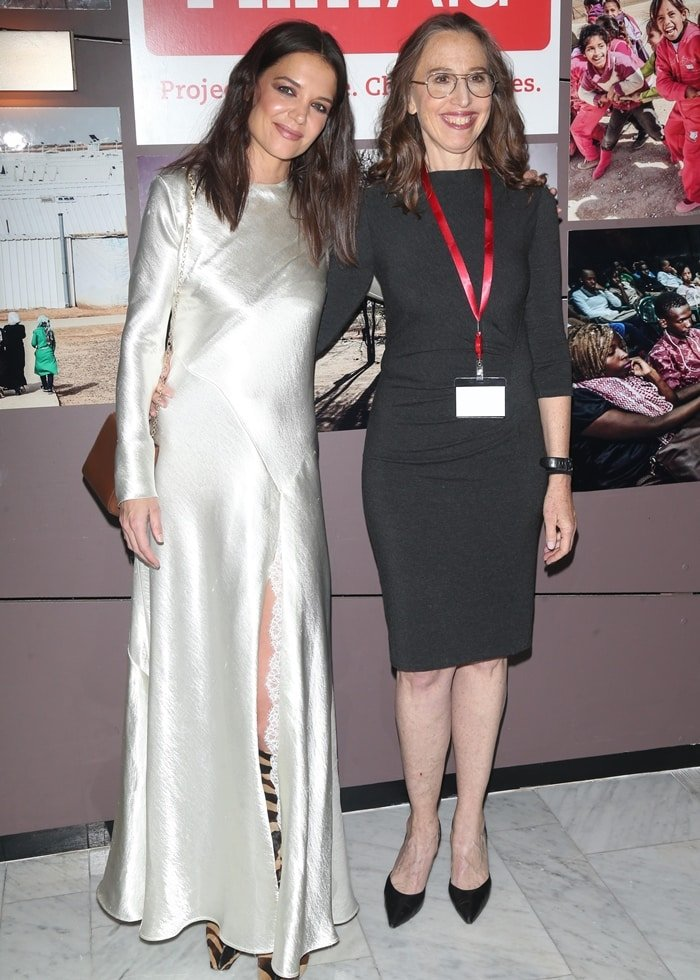 Katie Holmes posing with Caroline Baron, a New York-based film and television producer, humanitarian, entrepreneur and university professor