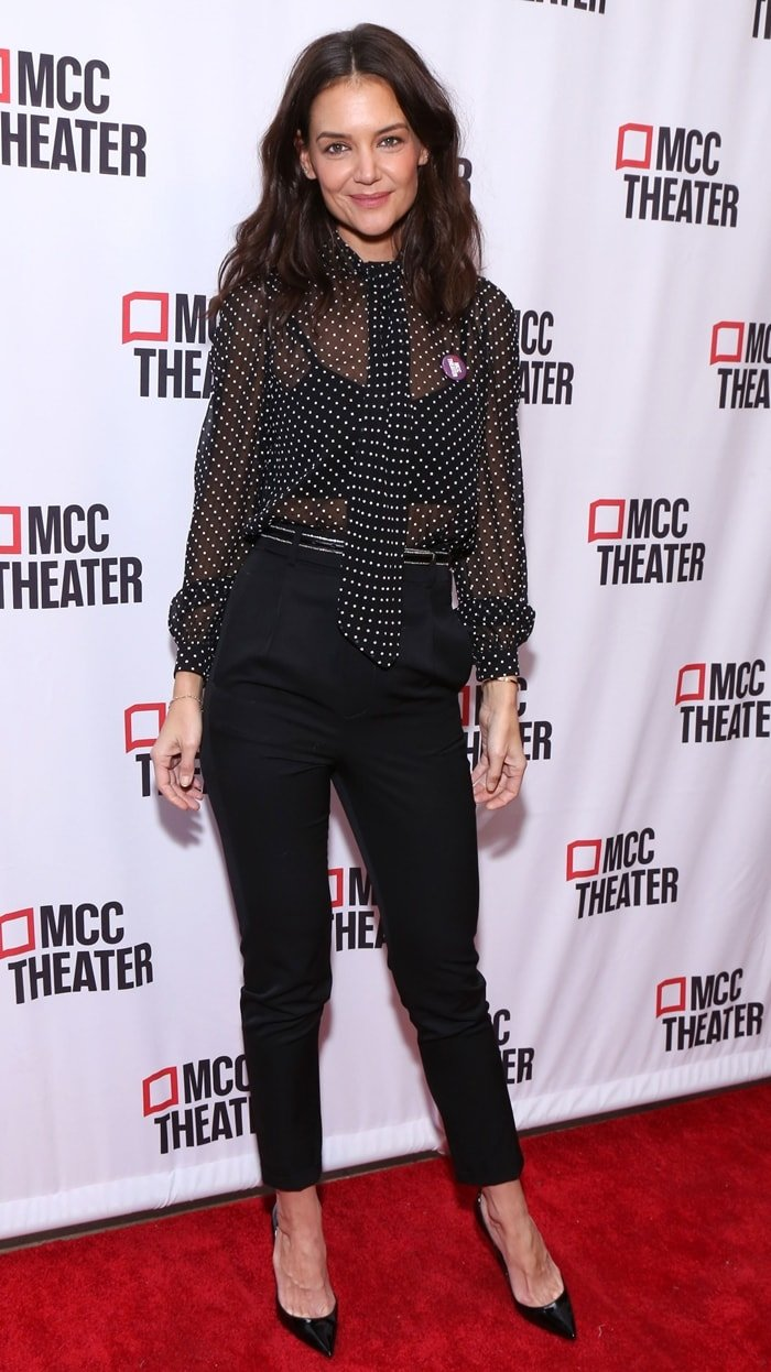 Katies Holmes in striped wool-twill slim-leg pants while attending MCC Theater's Inaugural Let's Play! Celebrity Game Night