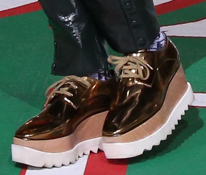 Kelly Rowland wears gold metallic Stella McCartney platform sneakers