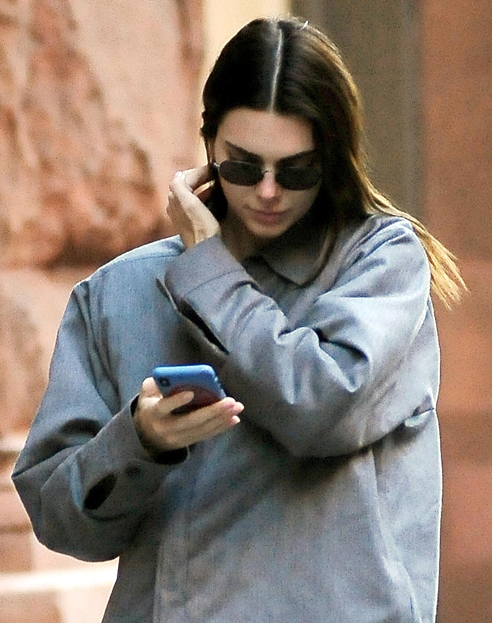 Kendall Jenner keeps a low profile in chic sunnies