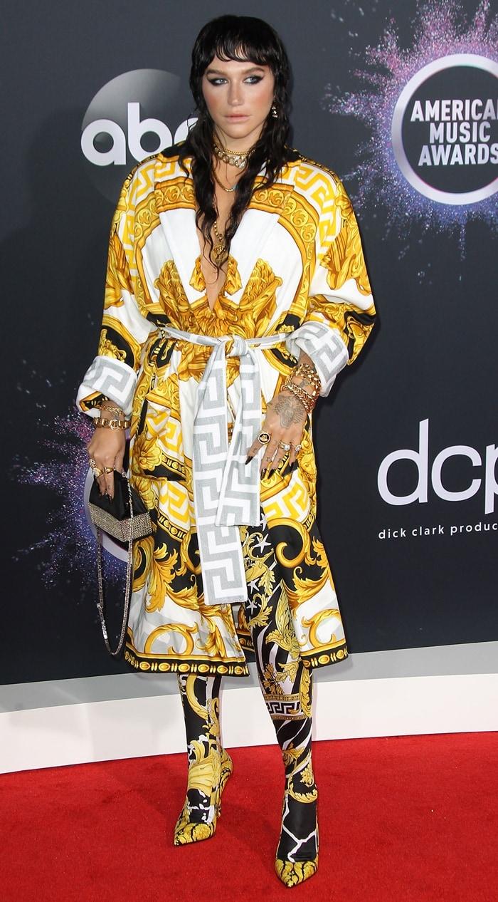 Kesha rocked Versace's La Coupe des Dieux robe and gold patterned leggings