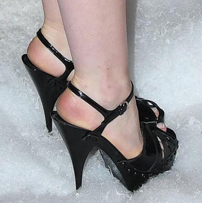 Kiernan Shipka displays her feet in Miu Miu studded black sandals
