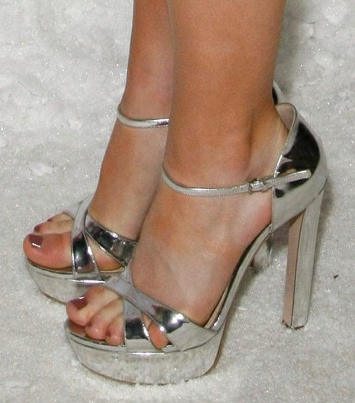 Kiernan Shipka shows her feet in metallic silver Miu Miu sandals