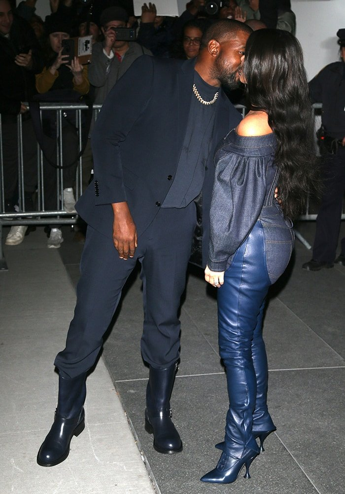 Kanye West and Kim Kardashian share a kiss as they arrived at the MoMA for the 2019 WSJ Innovator Awards on November 6, 2019
