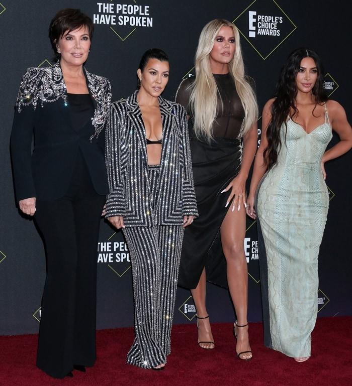 Kim, Kourtney, and Khloe Kardashian along with mom Kris Jenner at the 2019 E! People's Choice Awards