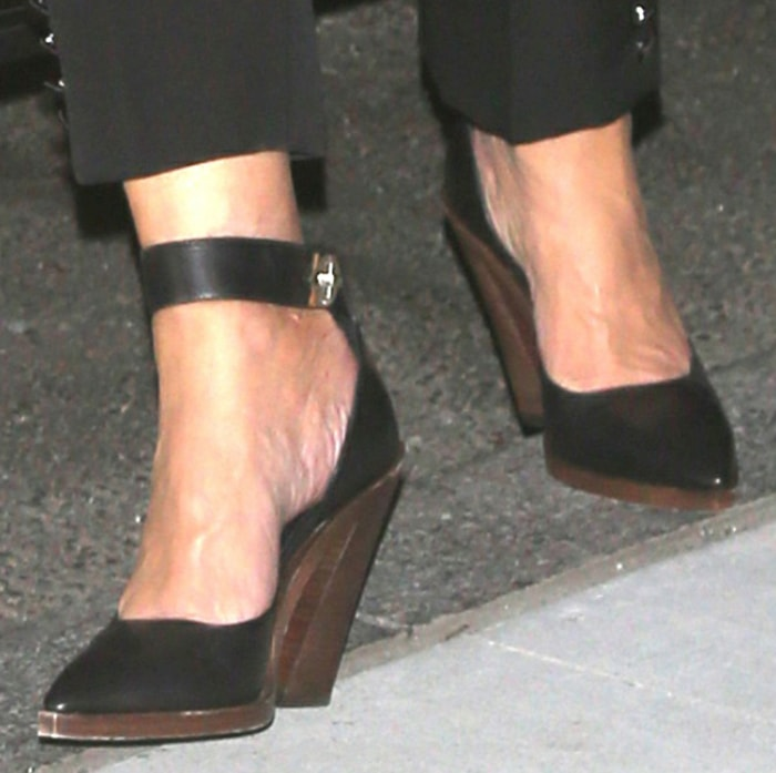 Kris Jenner balances on a pair of black d'Orsay pumps with wooden block heels