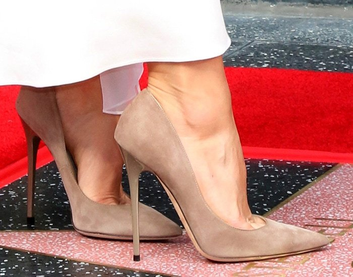 Kristen Bell finishes off her look with Jimmy Choo pumps
