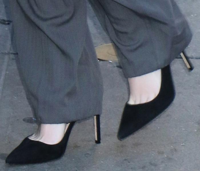Kristen Stewart teams her Acne Studios pantsuit with Manolo Blahnik black pumps