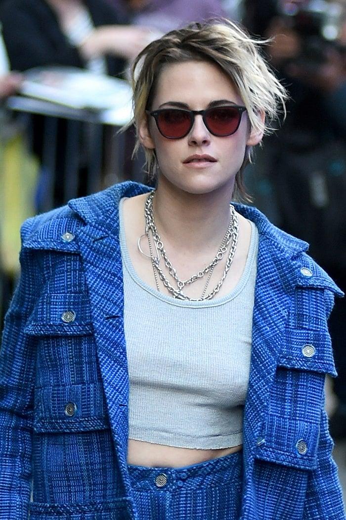 Kristen Stewart goes braless underneath her tank top and blazer