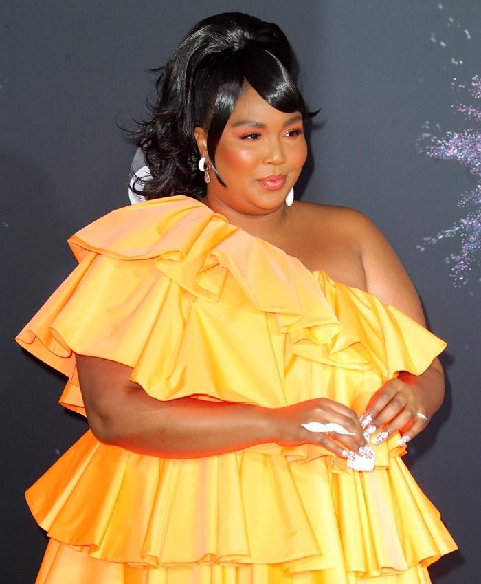 Lizzo's ruffled orange minidress from Valentino