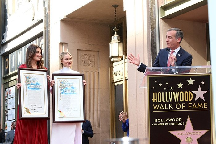 Los Angeles Mayor Eric Garcettipresents certificates to Idina Menzel and Kristen Bell