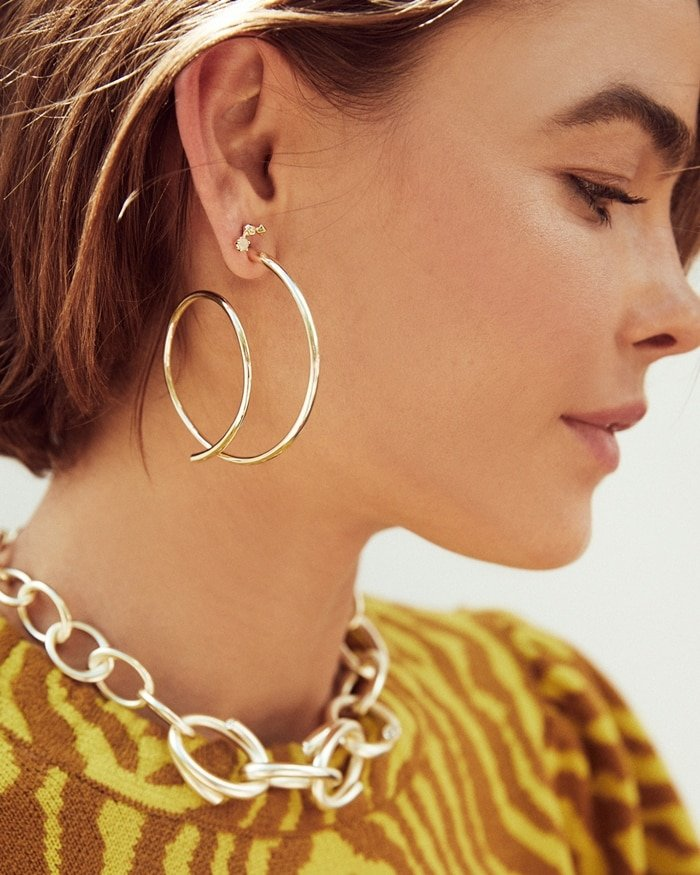 Pyramid crystals put the punctuation mark at the end of these artsy loopty loop earrings