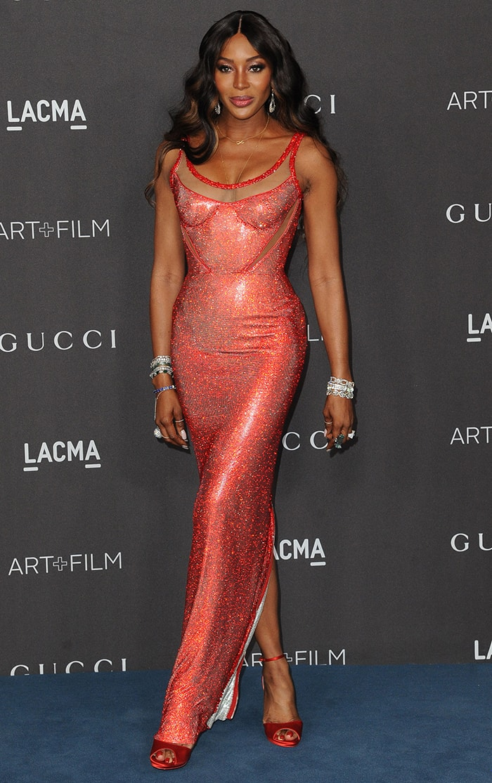 Naomi Campbell is a bombshell in Atelier Versace red crystal-encrusted dress