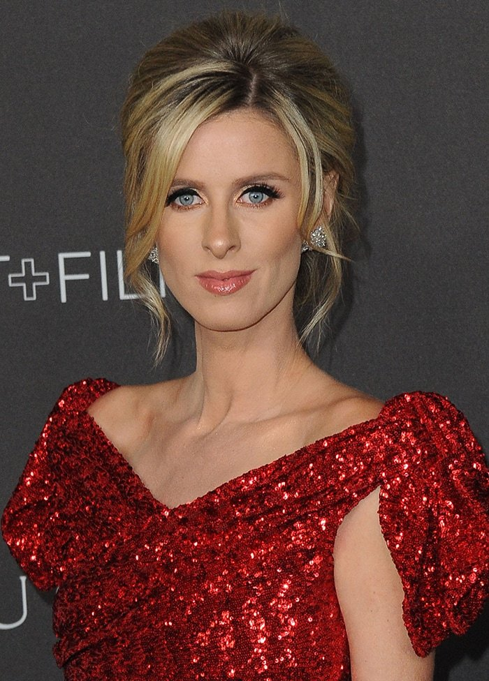 Nicky Hilton wears her hair in an elegant updo with complementing makeup
