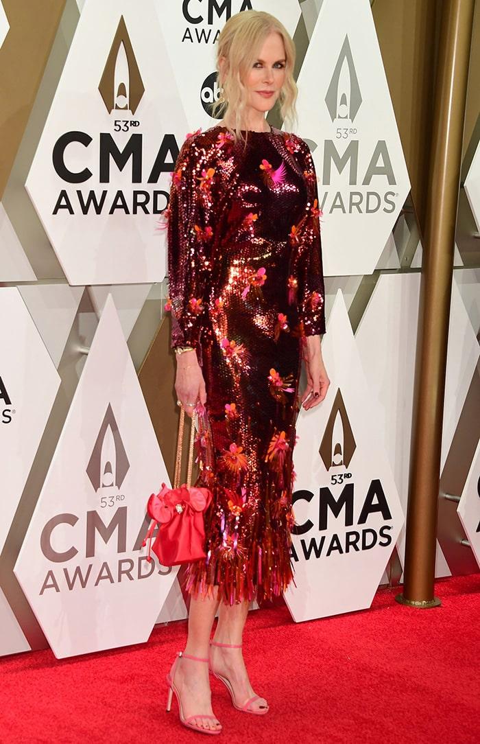 Nicole Kidman wears a red sequined Versace dress