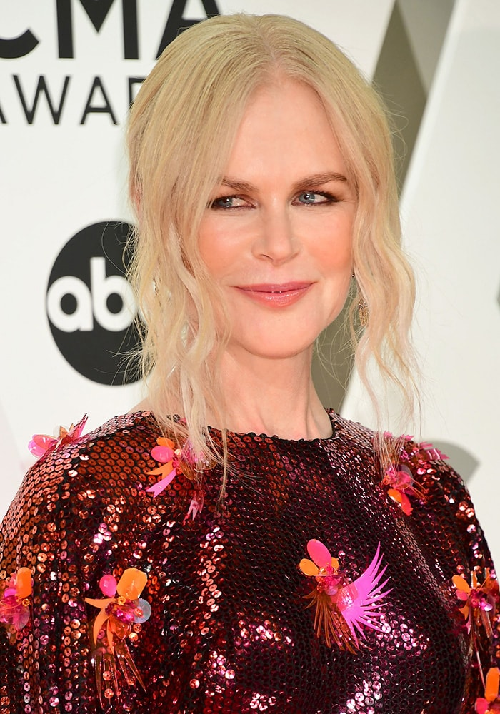 Nicole Kidman styles her blonde hair in a chic updo with face-framing tendrils