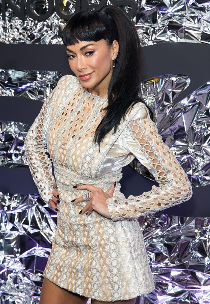 Nicole Scherzinger wears her hair in a ponytail with clip-in bangs