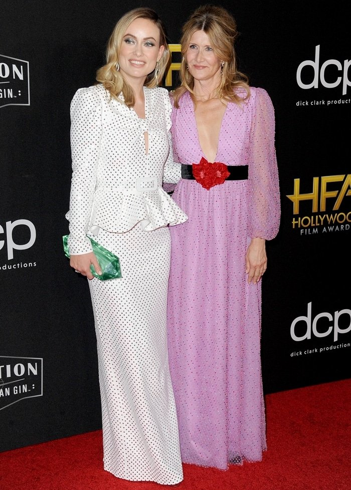 Olivia Wilde posing with Laura Dern, who donned a beautiful pink and red Markarian 'Cassiopeia' dress