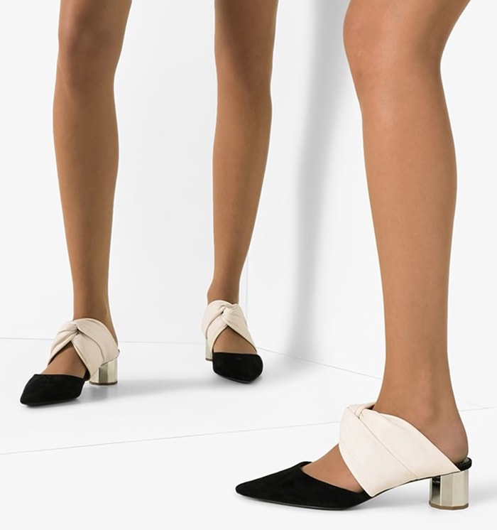 Crafted from white leather and black suede, these two-tone 40mm mules from Proenza Schouler feature an open back, a slip-on style, a knot detail, a pointed toe and a sculpted silver-tone low block heel