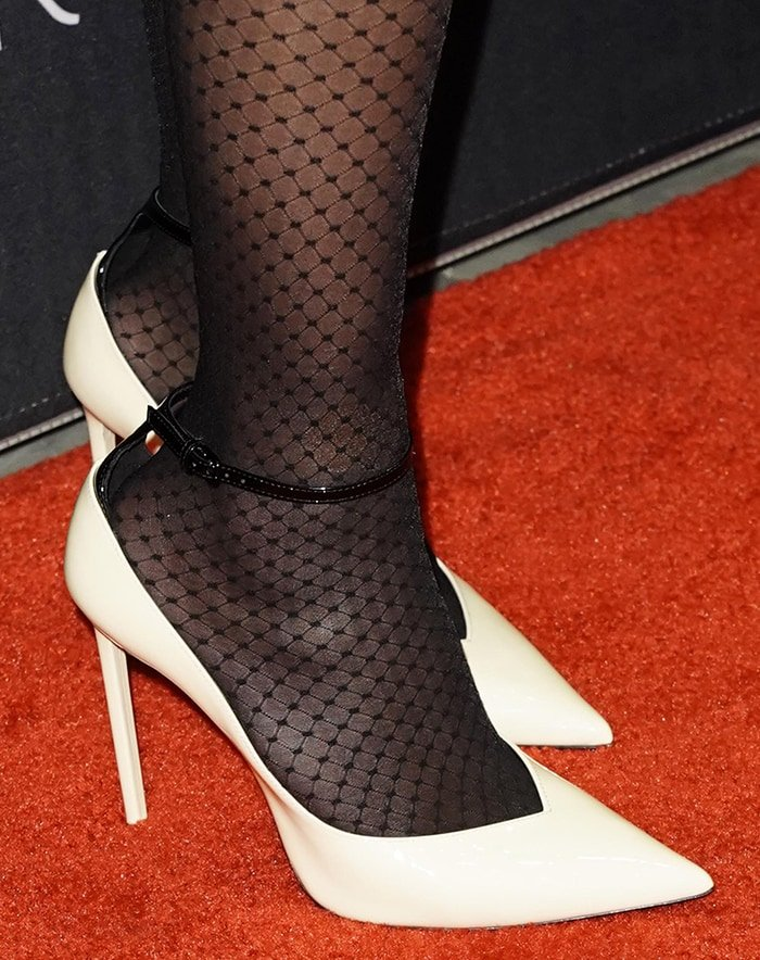 Reese Witherspoon wears dotted tights with Saint Laurent pumps