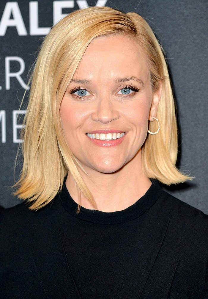 Reese Witherspoon sports soft pink makeup with unfussy hairstyle
