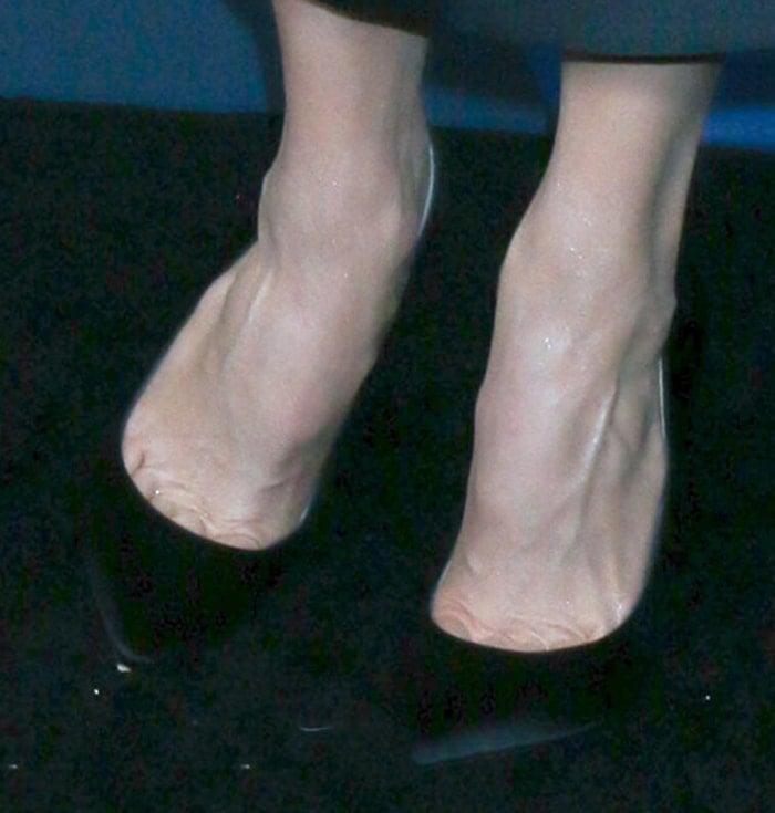 Renée Kathleen Zellweger shows off her feet in Jimmy Choo shoes